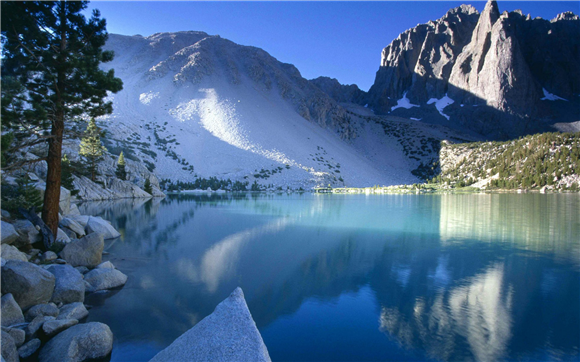 beautiful lake and mountains in sunlight